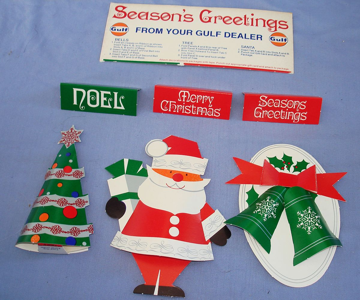 Vintage Gulf Dealer Seasons Greetings Merry Christmas Noel Bells Tree Santa Claus Decorations