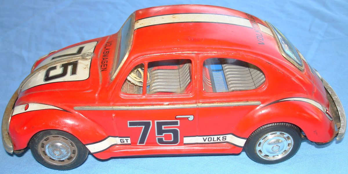 Vintage Taiyo Made In Japan German Volkswagen VW Battery Operated Tin Toy Car Driver