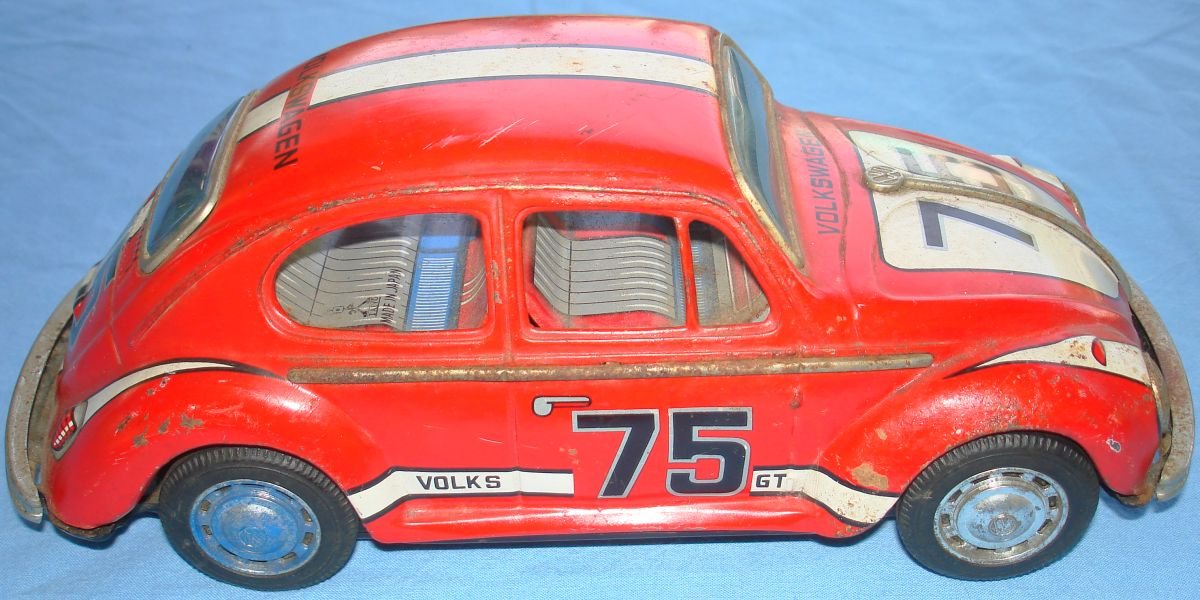 Taiyo Made In Japan German Volkswagen VW Battery Operated Tin Toy Car Passenger